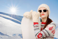 Portrait of a happy young girl snowboarding with sunglasses Stock Photography