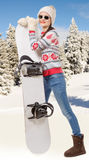 Portrait of a happy young girl snowboarding with sunglasses Stock Photos