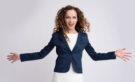 Portrait of happy young girl with stretched arms Stock Images
