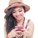 Portrait of a happy young girl was playing mobile phone Stock Photos