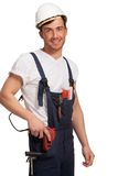 Portrait of happy young handyman with tool Stock Photography