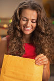 Portrait of happy young housewife opening package Stock Photography