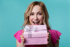 Cheerful woman is excited about present stock photography