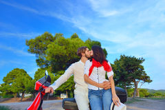 Portrait of happy young love couple on scooter enjoying themselves Stock Image