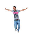 Portrait of a happy young male jumping in air Royalty Free Stock Photos