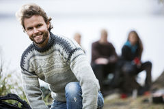 Portrait Of Happy Young Man At Campsite Royalty Free Stock Image