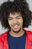 Portrait of happy young man with curly hair Royalty Free Stock Photos