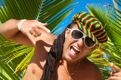 Portrait of happy young man with dreadlocks Stock Photo