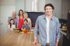 Portrait of happy young man with family in kitchen Stock Images