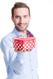 Portrait of happy young man with gift. Stock Photos