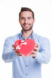 Portrait of happy young man with gift. Royalty Free Stock Photos