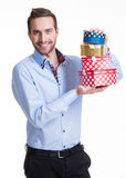 Portrait of happy young man with gifts. Royalty Free Stock Photo