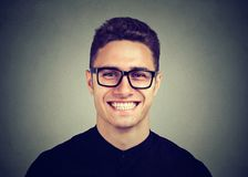 Portrait of a happy young man in glasses stock image