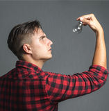 Portrait of a happy young man holding  light bulb Stock Image