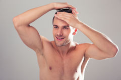 Portrait of a happy young man with nude torso Royalty Free Stock Photo