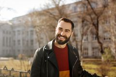 Portrait of happy young man outdoors. On sunny day royalty free stock image