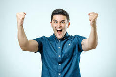 Portrait of happy young man raising his hands Royalty Free Stock Photography