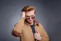 Portrait of a happy young man smiling on gray background Royalty Free Stock Photography