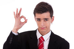 Portrait of a  happy young man, with thumbs raised Stock Images