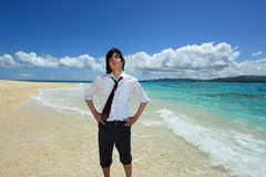Portrait of happy young man on a tropical beach Royalty Free Stock Photography