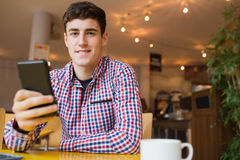 Portrait of happy young man using mobile phone Royalty Free Stock Image