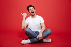 Portrait of a happy young man in white t-shirt Stock Image