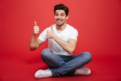 Portrait of a happy young man in white t-shirt Stock Images