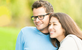 Portrait of happy young man and woman in park. Royalty Free Stock Image