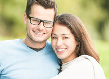 Portrait of happy young man and woman in park. stock photography