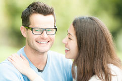 Portrait of happy young man and woman in park. Royalty Free Stock Photos