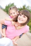 Portrait of happy young mother and daughter. Stock Photos