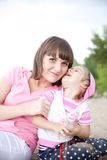 Portrait of happy young mother and daughter. Royalty Free Stock Image