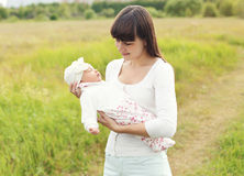 Portrait of happy young mother walking with infant outdoors Stock Images