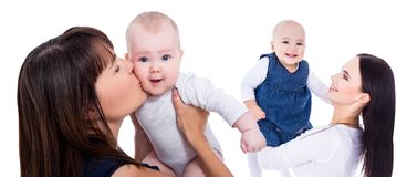 Portrait of happy young mothers playing with little daughters isolated on white royalty free stock image