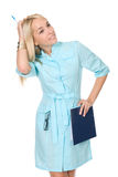 Portrait of a happy young nurse with file folders Royalty Free Stock Photo