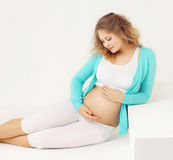 Portrait of happy young pregnant woman at home Stock Images