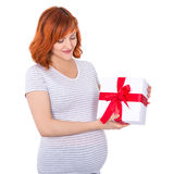 Portrait of happy young pretty pregnant woman with gift box isol Royalty Free Stock Photos