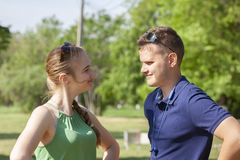 Portrait happy young smiling couple in love over flowering spring garden stock photo