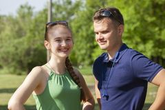 Portrait happy young smiling couple in love over flowering spring garden stock photography
