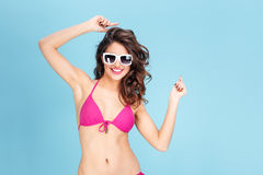 Portrait of a happy young smiling woman wearing sunglasses Stock Photography