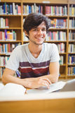 Portrait of happy young student using his laptop Stock Image
