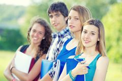 Portrait happy young students in park Stock Photography