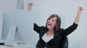 Exited, successful business woman. Portrait of happy young successful businesswoman celebrate something with arms up Stock Images