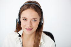 Portrait of happy young support phone operator with headset. Stock Images