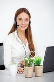 Portrait of happy young support phone operator with headset. Royalty Free Stock Photography