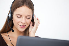 Portrait of happy young support phone operator with headset. Royalty Free Stock Photos