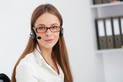 Portrait of happy young support phone operator with headset. Royalty Free Stock Images