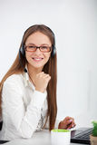 Portrait of happy young support phone operator with headset. Royalty Free Stock Image
