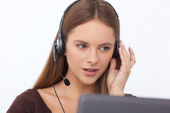 Portrait of happy young support phone operator with headset. Stock Photo