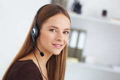 Portrait of happy young support phone operator with headset. Stock Photography